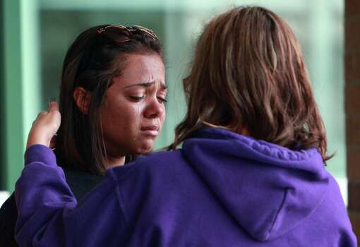 Khristian  Friels, 17, is comforted by teacher Christina Hicks as she weeps outside of Spring High School on Friday, Sept. 6, 2013, in Spring. Photo: Mayra Beltran, Houston Chronicle / © 2013 Houston Chronicle