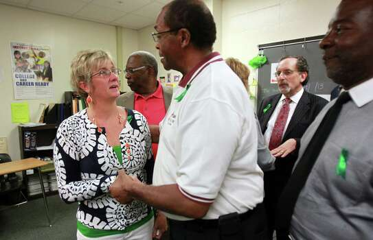 SHS Principal Donna Ullrich is greeted by pastors who attended the press conference at Spring High School on Friday, Sept. 6, 2013, in Spring. Photo: Mayra Beltran, Houston Chronicle / © 2013 Houston Chronicle