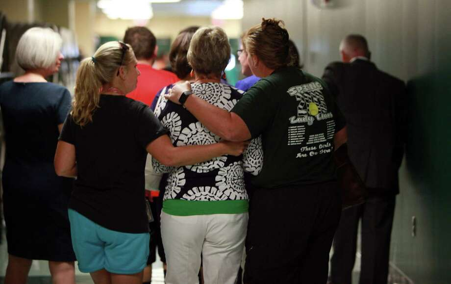 Teachers Erica Rutledge and Julie Wyrick embrace SHS Principal Donna Ullrich after the press conference at Spring High School on Friday, Sept. 6, 2013, in Spring. Photo: Mayra Beltran, Houston Chronicle / © 2013 Houston Chronicle