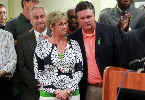 Donna Ullrich, Principal of Spring High, is patted on the back by Pastor Mark Estep, of Spring Baptist Church, during a press conference at Spring High School on Friday, Sept. 6, 2013, in Spring. Photo: Mayra Beltran, Houston Chronicle / © 2013 Houston Chronicle