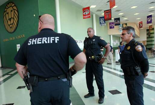 A strong presence of Sheriff Deputies and SISD Police were at Spring High School on Friday, Sept. 6, 2013, in Spring. Photo: Mayra Beltran, Houston Chronicle / © 2013 Houston Chronicle
