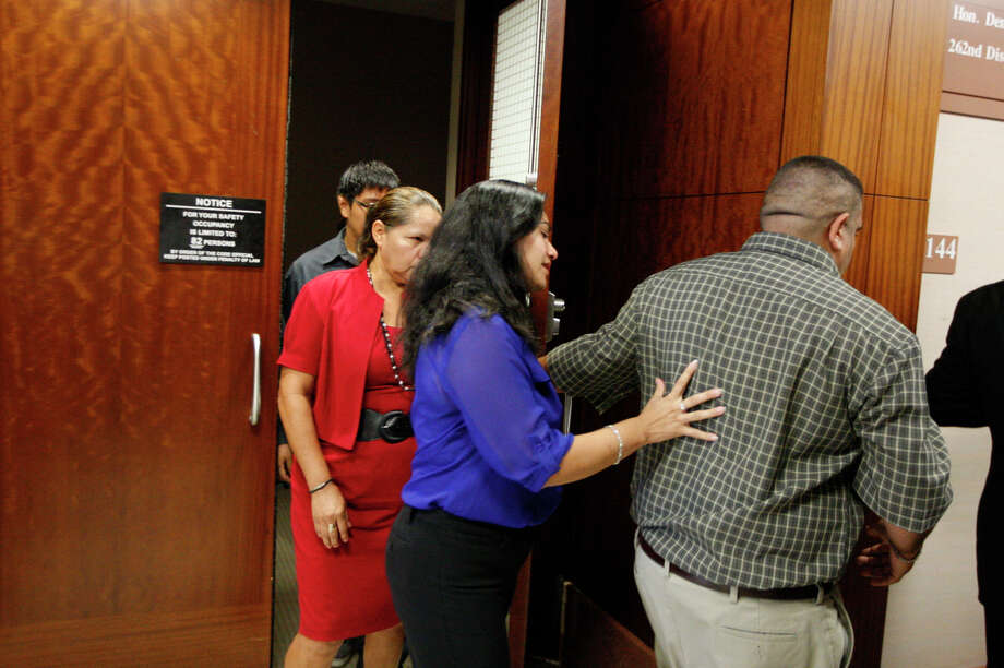Family members of Luis Alonzo Alfaro, 17, leave the 262nd District Court on Friday, Sept. 6, 2013, in Houston.  Alfaro is charged with murder accused of fatally stabbing 17-year-old Joshua Broussard at Spring High School. Photo: J. Patric Schneider, For The Chronicle / © 2013 Houston Chronicle