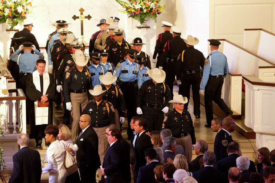 Law enforcement personnel, along with other mourners, leave the First Presbyterian Church after District Attorney Mike Anderson's funeral service, Friday, Sept. 6, 2013, in Houston. Anderson died after a battle with cancer. Photo: Cody Duty, Houston Chronicle / © 2013 Houston Chronicle