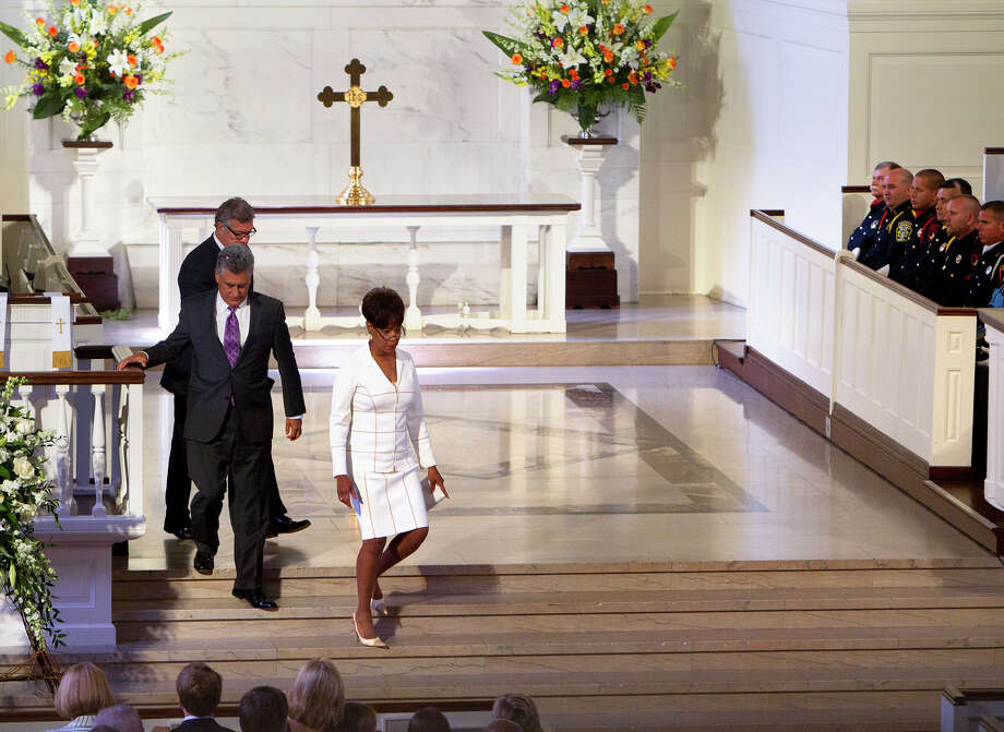 Mike Massey, rear, Paul Schiffer, center, and Belinda Hill return to their seats after speaking words of remembrance during District Attorney Mike Anderson's funeral service at the First Presbyterian Church, Friday, Sept. 6, 2013, in Houston. Anderson died after a battle with cancer. Photo: Cody Duty, Houston Chronicle / © 2013 Houston Chronicle