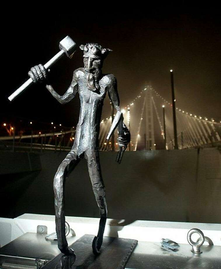The rumors of a new troll on the eastern span of the Bay Bridge apparently are true, with the sudden appearance of an actual photo of the odd fellow that captured him with a sledgehammer in his hand, ready to protect the bridge and serve as a good-luck token for all who cross. Photo: Noah Berger, Metropolitan Transportation Comm