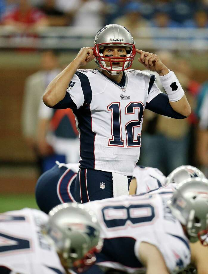 DETROIT, MI - AUGUST 22: Tom Brady #12 of the New England Patriots makes changes at the line of scrimmage while playing the Detroit Lions during a pre season game at Ford Field on August 22, 2013 in Detroit, Michigan. Photo: Gregory Shamus, Getty Images / 2013 Getty Images