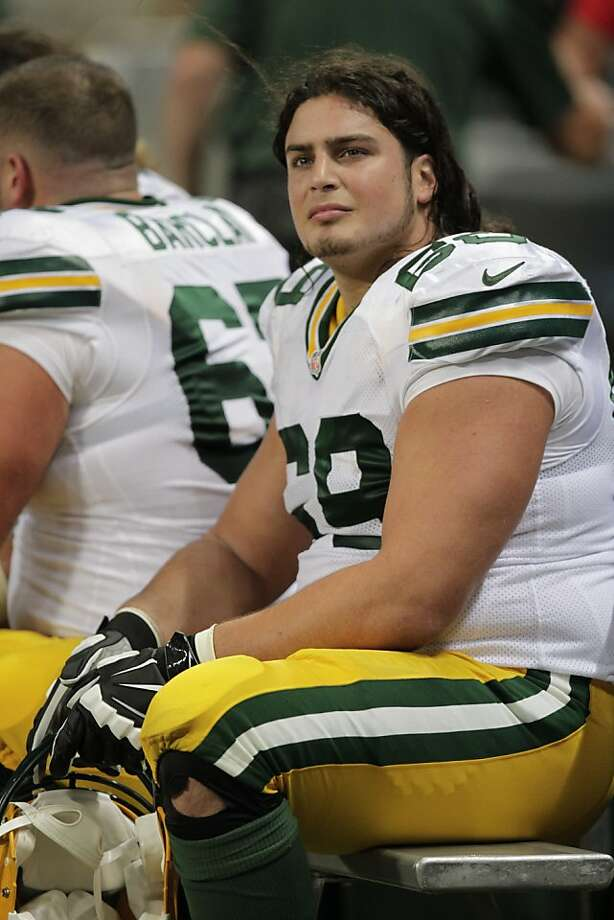 Green Bay Packers offensive tackle David Bakhtiari sits on the bench during the second quarter of an NFL football game against the St. Louis Rams Saturday, Aug. 17, 2013, in St. Louis. (AP Photo/Tom Gannam) Photo: Tom Gannam, Associated Press