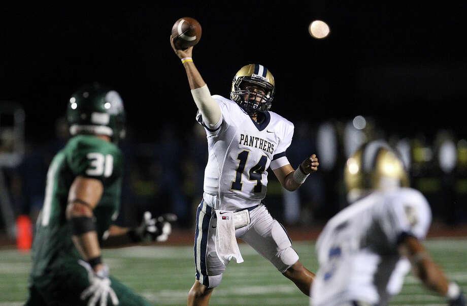 O'Connor quarterback Zach Galindo (14) throws to a receiver against the Reagan defense during their game at Comalander Stadium on Friday, Sept. 6, 2013. Photo: Kin Man Hui, San Antonio Express-News / ©2013 San Antonio Express-News