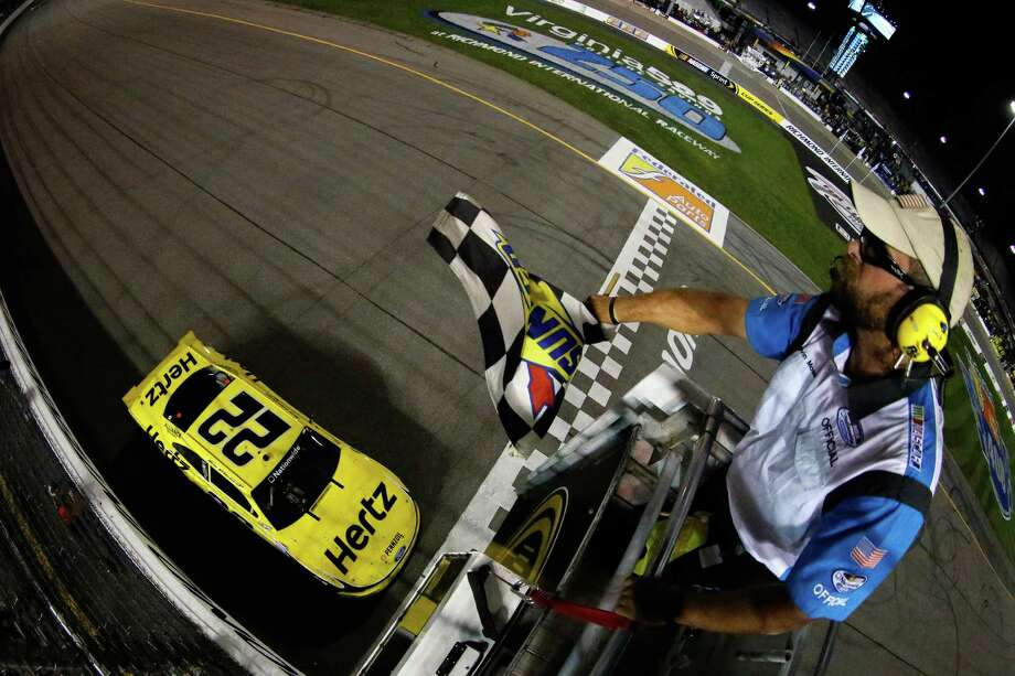 Brad Keselowski guides his car to the finish line for his 25th career Nationwide Series victory in Friday night's race in Richmond, Va. Photo: Chris Graythen, Handout / 2013 NASCAR