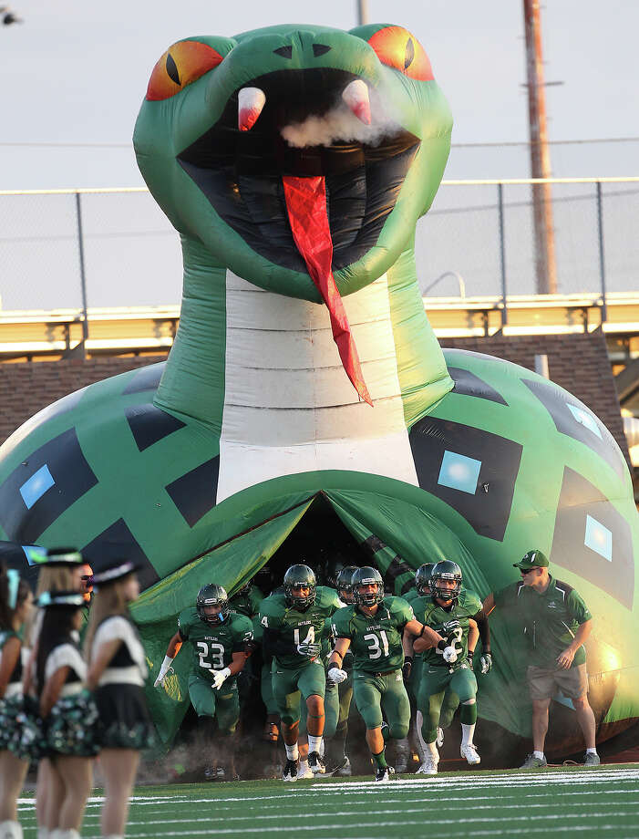The Reagan Rattlers take the field against O'Connor for their game at Comalander Stadium on Friday, Sept. 6, 2013. Photo: Kin Man Hui, San Antonio Express-News / ©2013 San Antonio Express-News