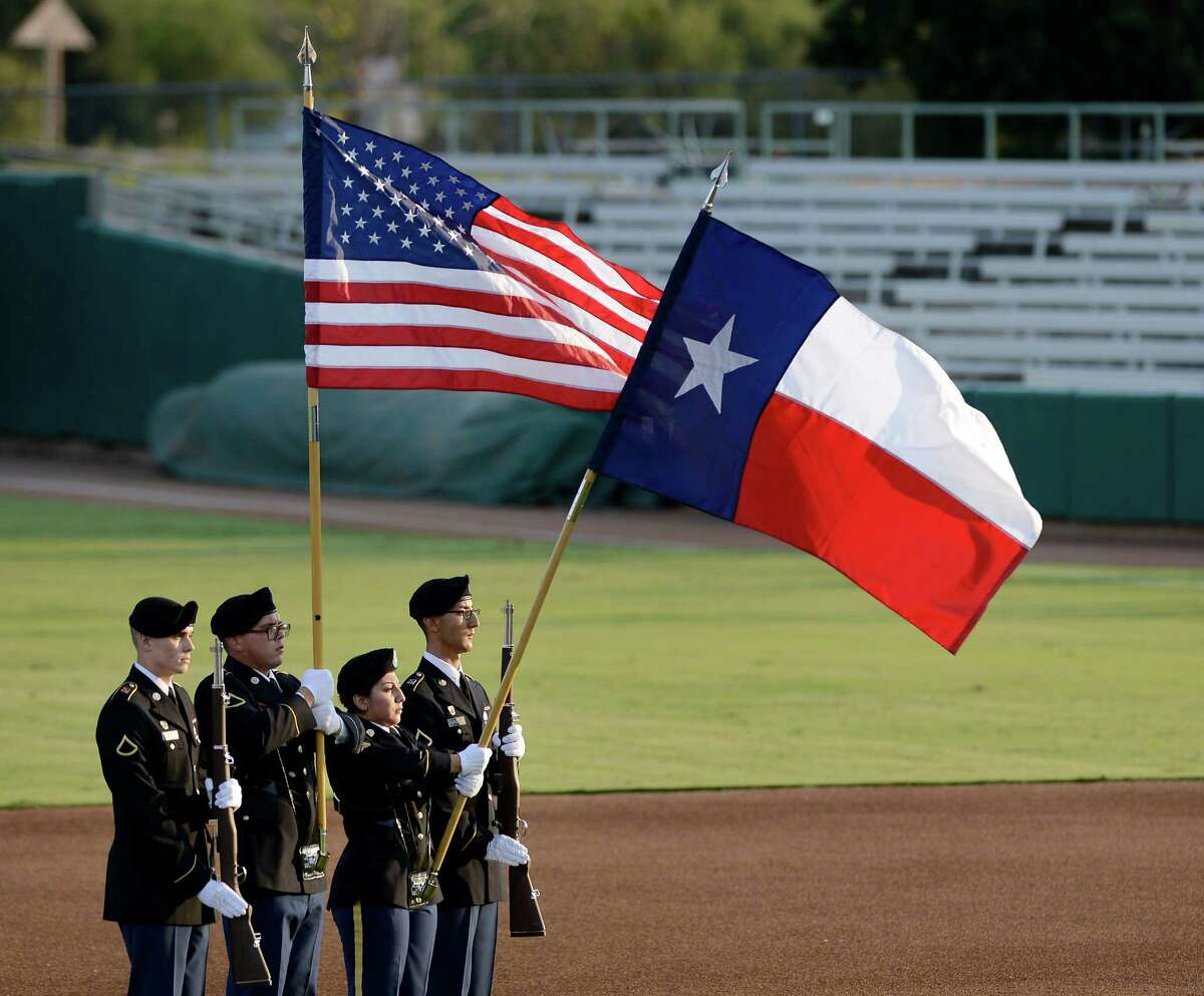 Colors are displayed for the national anthem before a Texas League playoff baseball game between the Corpus Christi Hooks and the San Antonio Missions, Friday, Sept. 6, 2013, at Nelson Wolff Municipal Stadium in San Antonio. (Darren Abate/For the Express-News)