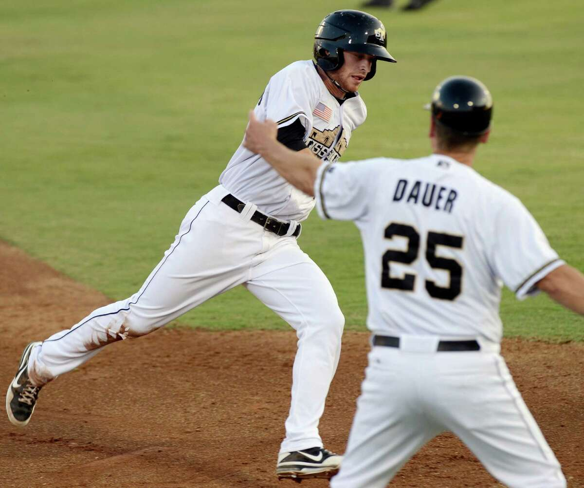 San Antonio Missions' Cory Spangenberg is waved past third by Missions manager Rich Dauer (25) during a Texas League playoff baseball game against the Corpus Christi Hooks, Friday, Sept. 6, 2013, at Nelson Wolff Municipal Stadium in San Antonio. (Darren Abate/For the Express-News)
