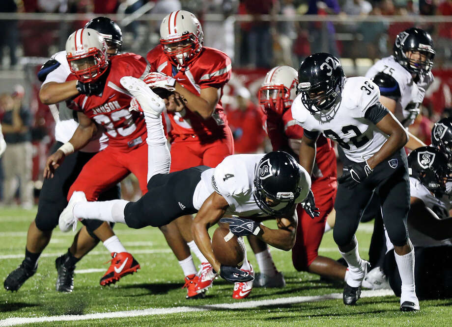 Steele's Justin Stockton dives into the end zone for a touchdown against Judson during second half action Friday Sept. 6, 2013 at D.W. Rutledge Stadium. Steele won 51-34. Photo: Edward A. Ornelas, San Antonio Express-News / © 2012 San Antonio Express-News