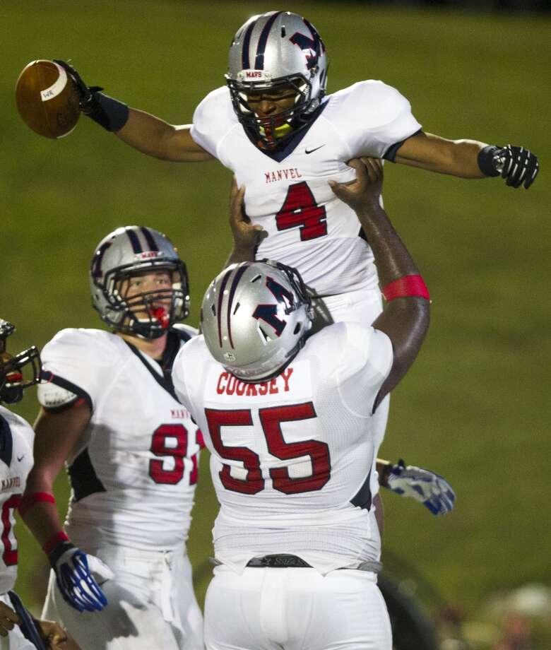 Manvel wide receiver Austin Alexis (4) is congratulated by teammate Kaelin Cooksey (55) after scoring a touchdown during the first half of a high school football game on Friday, Sept. 6, 2013, in Galena Park. ( J. Patric Schneider / For the Chronicle ) Photo: J. Patric Schneider, For The Chronicle