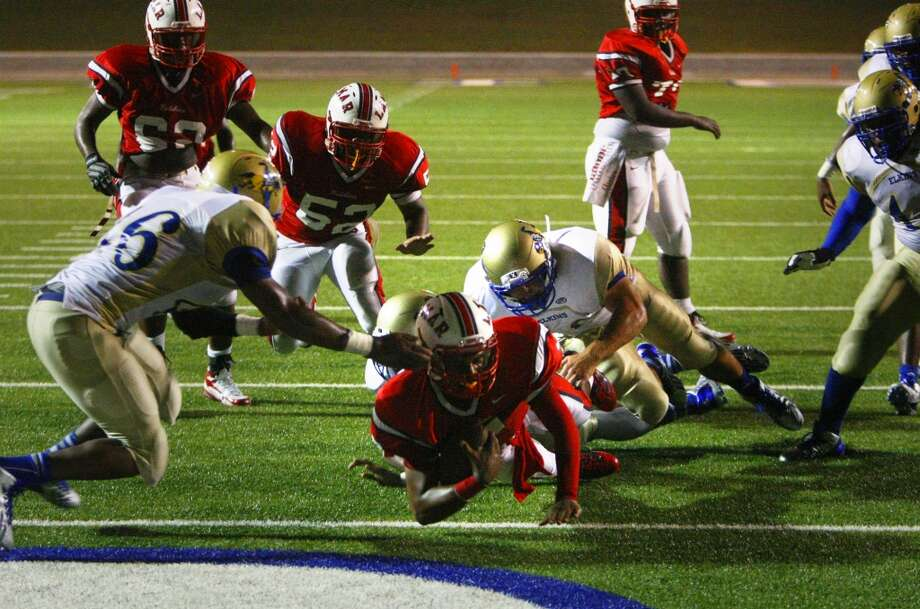 Lamar High School quarterback Darrell Colbert dives into the end zone for a touchdown during the second half against Elkins High School at Delmar Stadium, Friday, Sept. 6, 2013, in Houston. (Cody Duty / Houston Chronicle) Photo: Cody Duty, Houston Chronicle