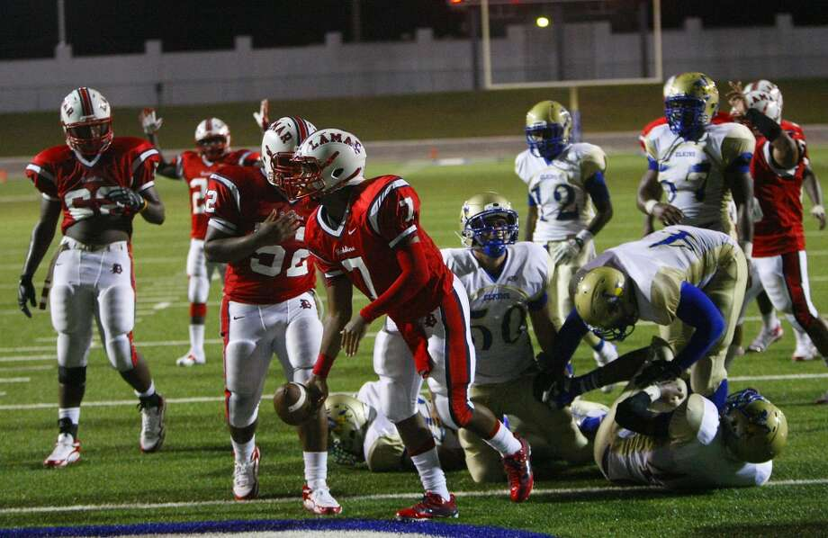 Lamar High School quarterback Darrell Colbert gets up after diving into the end zone for a touchdown during the second half against Elkins High School at Delmar Stadium, Friday, Sept. 6, 2013, in Houston. (Cody Duty / Houston Chronicle) Photo: Cody Duty, Houston Chronicle