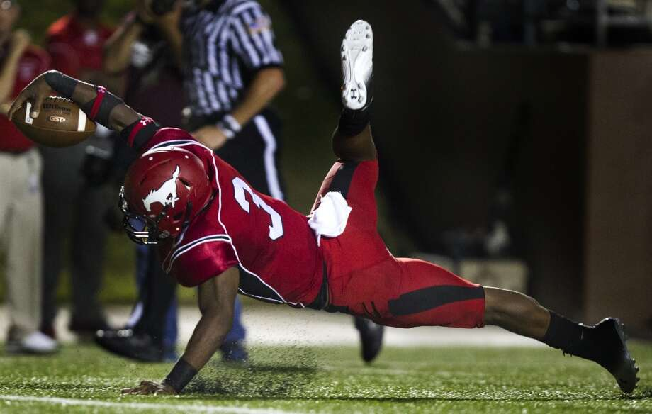 North Shore quarterback Maciah Long (3) dives in for a touchdown during the first half of a high school football game against Manvel on Friday, Sept. 6, 2013, in Galena Park. ( J. Patric Schneider / For the Chronicle ) Photo: J. Patric Schneider, For The Chronicle