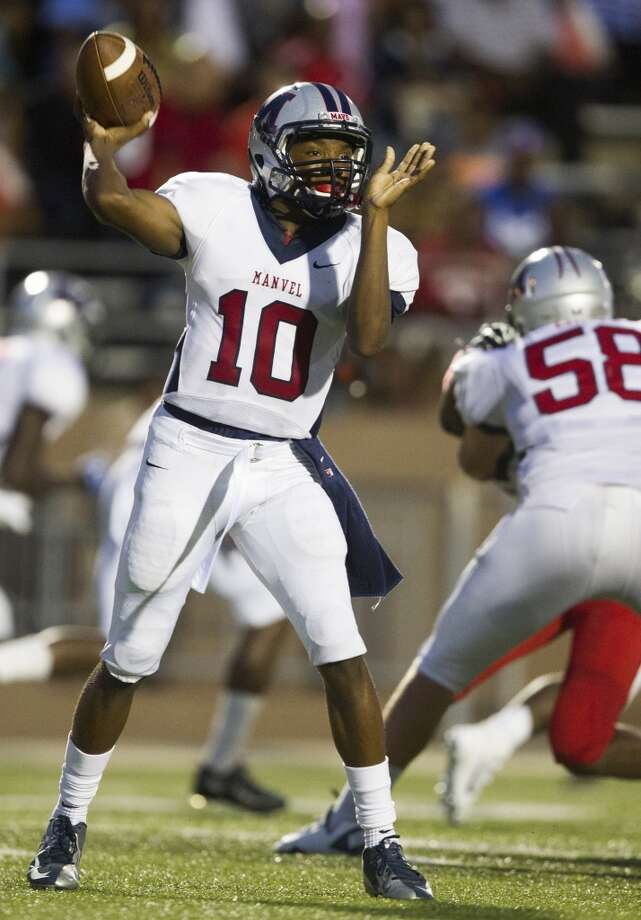 Manvel quarterback Deriq King (10) looks for an open man during the first half of a high school football game against North Shore on Friday, Sept. 6, 2013, in Galena Park. ( J. Patric Schneider / For the Chronicle ) Photo: J. Patric Schneider, For The Chronicle