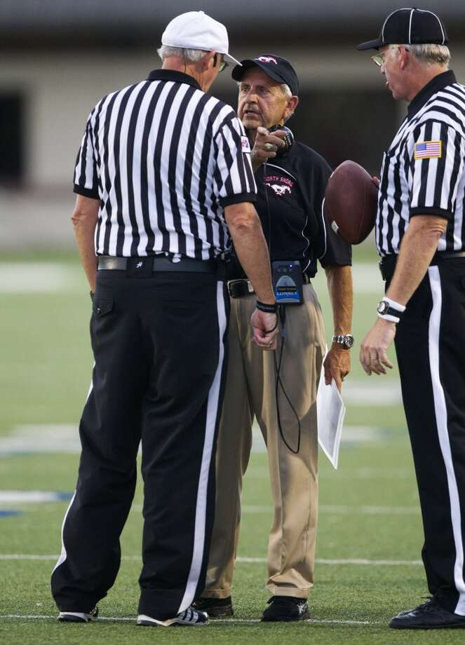 North Shore head coach David Aymond talks with the referees about a spot on a punt during the first half of a high school football game against Manvel on Friday, Sept. 6, 2013, in Galena Park. ( J. Patric Schneider / For the Chronicle ) Photo: J. Patric Schneider, For The Chronicle