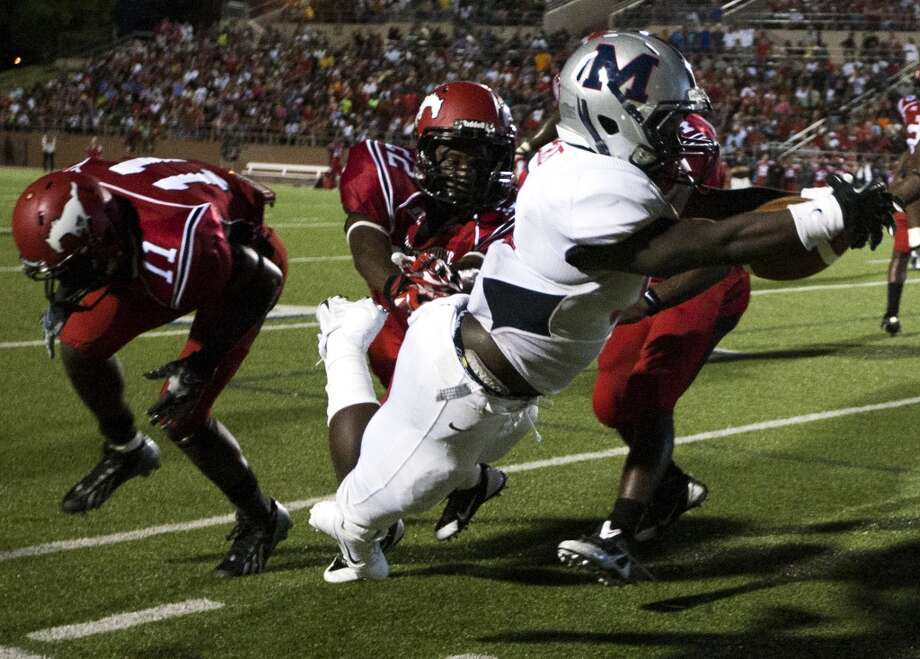 Manvel running back Jacoby Perro dives for the end zone but falls short during the first half of a high school football game against North Shore on Friday, Sept. 6, 2013, in Galena Park. ( J. Patric Schneider / For the Chronicle ) Photo: J. Patric Schneider, For The Chronicle