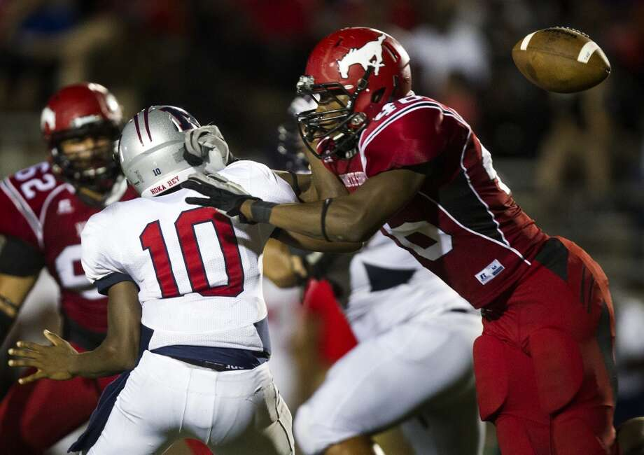 North Shore defensive lineman Dorance Armstrong causes Manvel quarterback Deriq King to fumble the ball during the second half of a high school football game on Friday, Sept. 6, 2013, in Galena Park. Manvel recovered the ball. ( J. Patric Schneider / For the Chronicle ) Photo: J. Patric Schneider, For The Chronicle