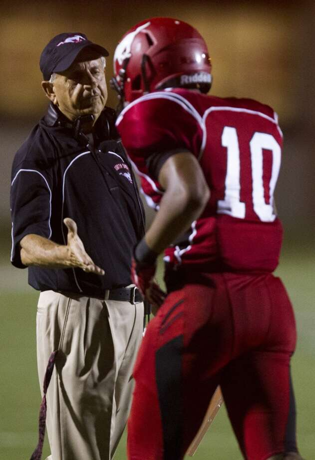 North Shore running back Justin Green (10) is congratulated by head coach David Aymond after scoring a touchdown during the second half of a high school football game against Manvel on Friday, Sept. 6, 2013, in Galena Park. North Shore defeated Manvel 24-20. ( J. Patric Schneider / For the Chronicle ) Photo: J. Patric Schneider, For The Chronicle