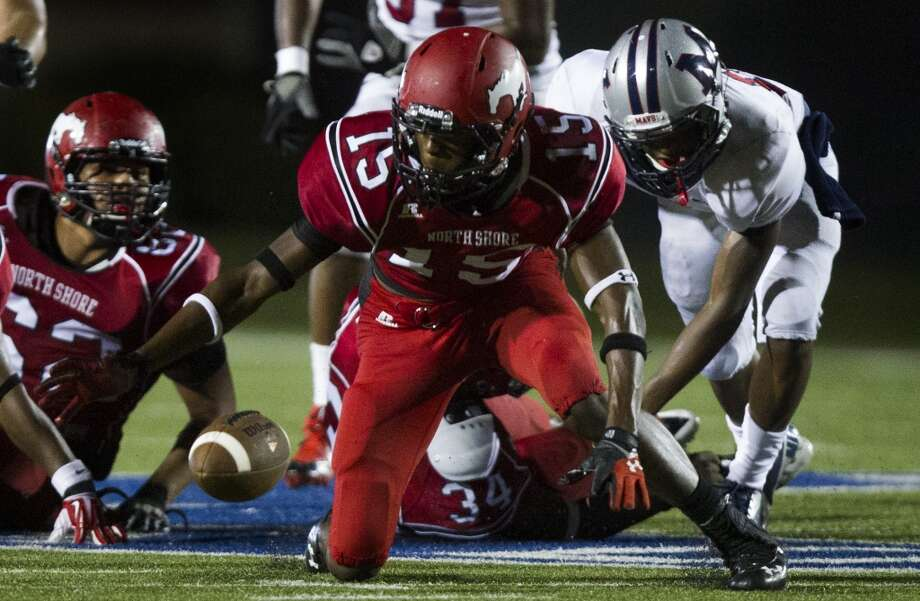 North Shore defensive back Derec Burks (15) recovers a fumble from Manvel during the second half of a high school football game on Friday, Sept. 6, 2013, in Galena Park. North Shore defeated Manvel 24-20. ( J. Patric Schneider / For the Chronicle ) Photo: J. Patric Schneider, For The Chronicle