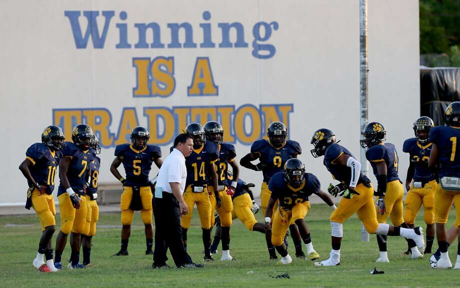 9/6/13: La Marque warms up before playing against Texas City at Etheredge Stadium in La Marque, Texas. Photo: Thomas B. Shea, For The Chronicle