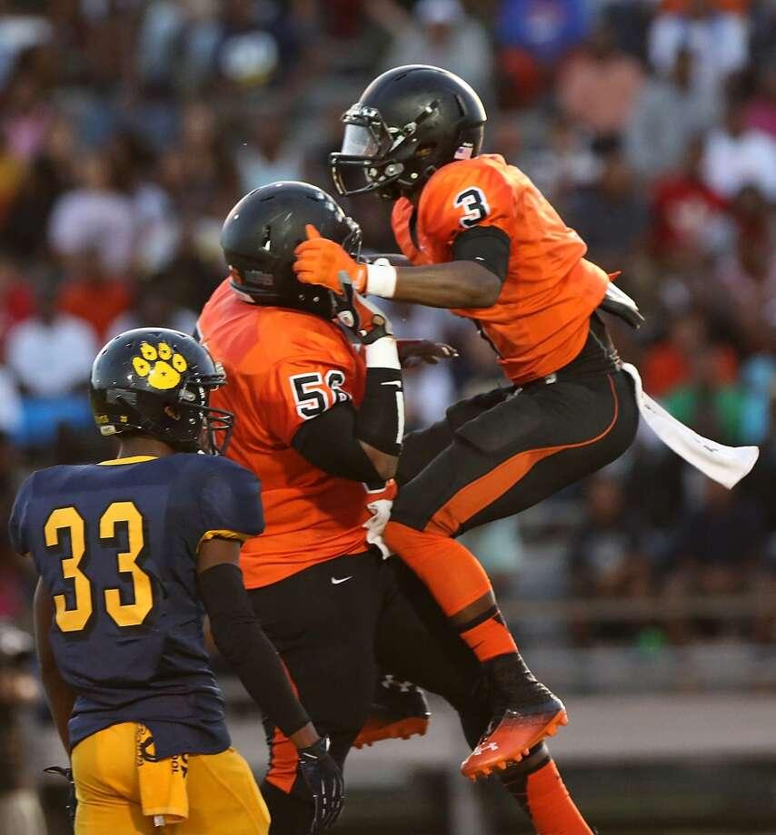 9/6/13: Texas City's Armanti Foreman #3 celebrates a touchdown reception with Gabe Garza #58 against La Marque at Etheredge Stadium in La Marque, Texas. Photo: Thomas B. Shea, For The Chronicle