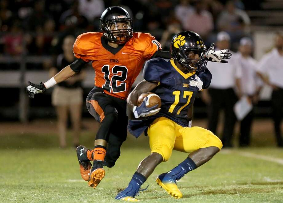 9/6/13: Texas City's Brandon Edmonds #12 chases down  La Marque's Dailon Richard #17 at Etheredge Stadium in La Marque, Texas. Photo: Thomas B. Shea, For The Chronicle