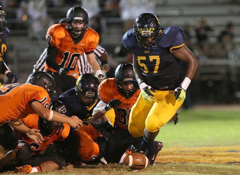 9/6/13: Texas City's Xavier Woodkins falls and recovers a La Marque fumble at Etheredge Stadium in La Marque, Texas. Photo: Thomas B. Shea, For The Chronicle