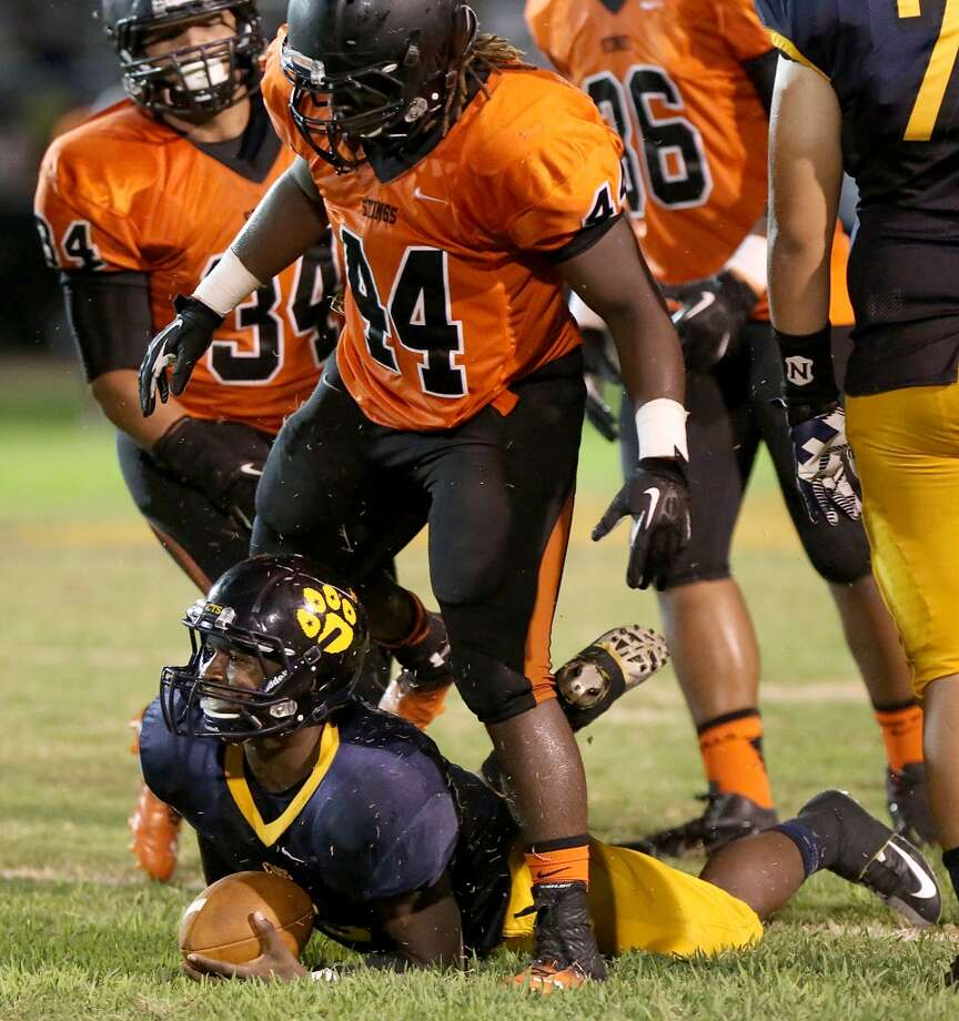 9/6/13: Texas City's Franciuos Bonnilla #44 stands over La Marque's  Ladarrian Ellis-Jones #6 after sacking him at Etheredge Stadium in La Marque, Texas. Photo: Thomas B. Shea, For The Chronicle