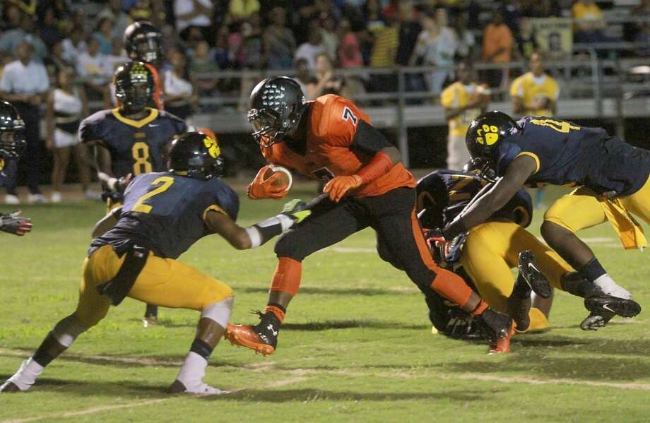9/6/13: Texas City 's running back D'Onta Foreman #7 runs over  La Marque's Demetrius James #2 for a rushing touchdown at Etheredge Stadium in La Marque, Texas. Photo: Thomas B. Shea, For The Chronicle