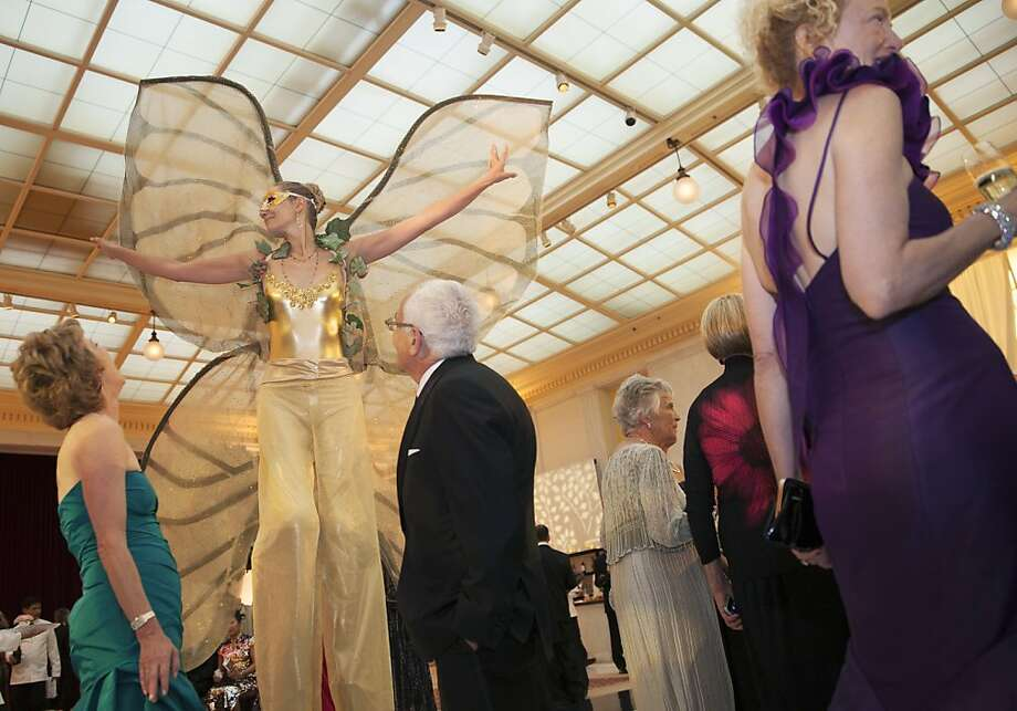 A performer dressed as a butterfly wearing stilts entertains guests at the 91st San Francisco Season Opening Opera Gala at City Hall on Friday, Sept. 6, 2013. The decor designed by Colin Cowie was themed 'The Garden of Good and Evil'. Photo: Alex Washburn, Special To The Chronicle