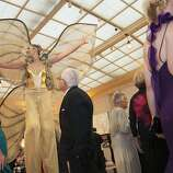 A performer dressed as a butterfly wearing stilts entertains guests at the 91st San Francisco Season Opening Opera Gala at City Hall on Friday, Sept. 6, 2013. The decor designed by Colin Cowie was themed 'The Garden of Good and Evil'.