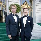 President of Banana Republic, Inc. Jack Calhoun and his partner Trent Norris pose as they enter San Francisco City Hall for the 91st San Francisco Season Opening Opera Gala on Friday, Sept. 6, 2013.  Calhoun was of course wearing a custom Banana Republic suit.