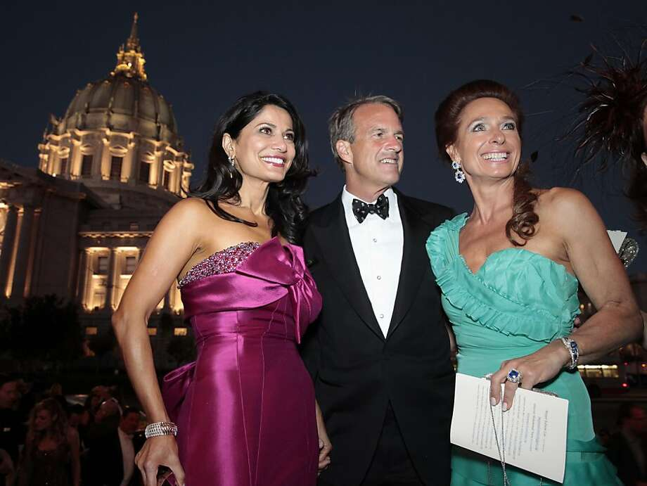Opera Ball co-chairwoman Mai Sharif Shiver (left) enters The War Memorial Opera House with Charles Githler and Elisabeth Thieriot for the 91st San Francisco Season-Opening Opera Gala performance in San Francisco Calif. on Friday, Sept. 6, 2013. Photo: Alex Washburn, Special To The Chronicle