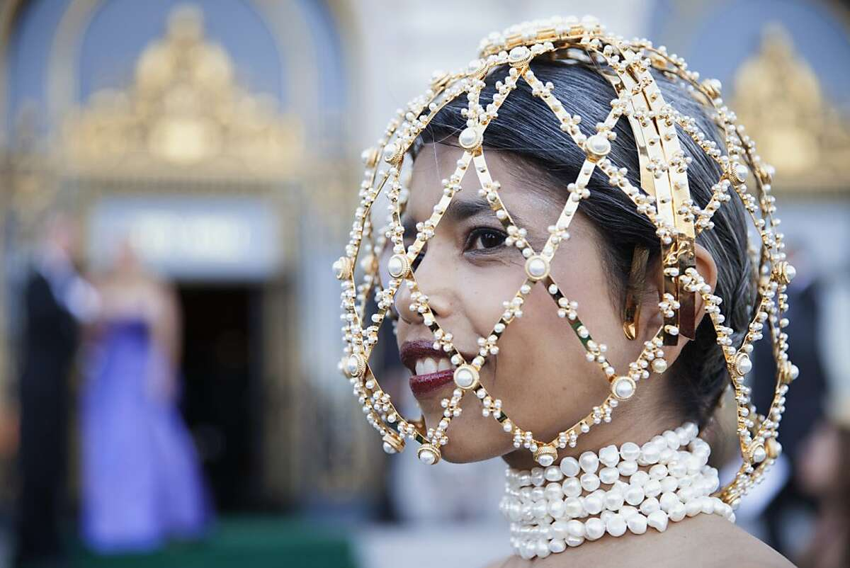 Deepa Pakianathan peeks out from her custom Alexander McQueen 'cage' as she arrives to the 91st San Francisco Season-Opening Opera Gala in San Francisco Calif. on Friday, Sept. 6, 2013.