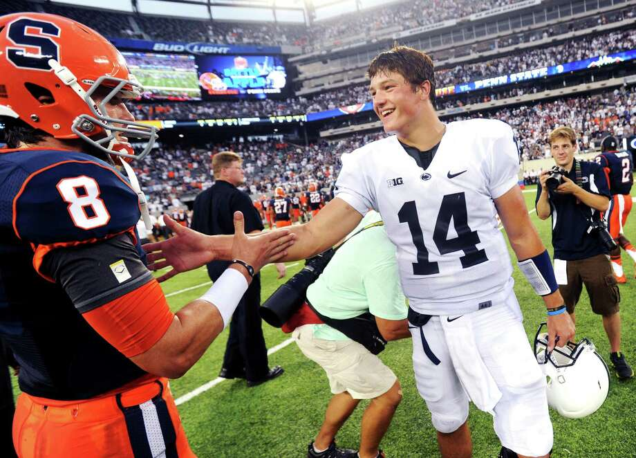 Penn State quarterback Christian Hackenberg talks to Syracuse quarterback  Drew Allen after an an NCAA college football game,  Saturday, Aug. 31, 2013, in East Rutherford, N.J. Penn State won 23-17. (AP Photo/York Daily Record, Jason Plotkin)  YORK DISPATCH OUT   ORG XMIT: PAYOK113 Photo: JASON PLOTKIN / York Daily Record