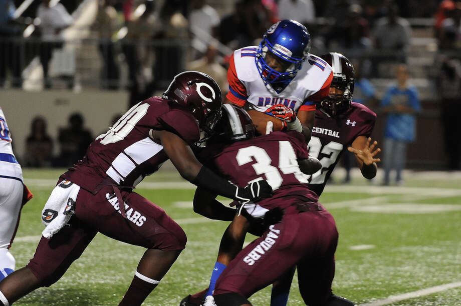 Central players close work to gether to bring down West Brook's Keith Corbin, 11, at the Carroll Thomas Stadium Friday night. Photo provided by Drew Loker. Photo: Drew Loker