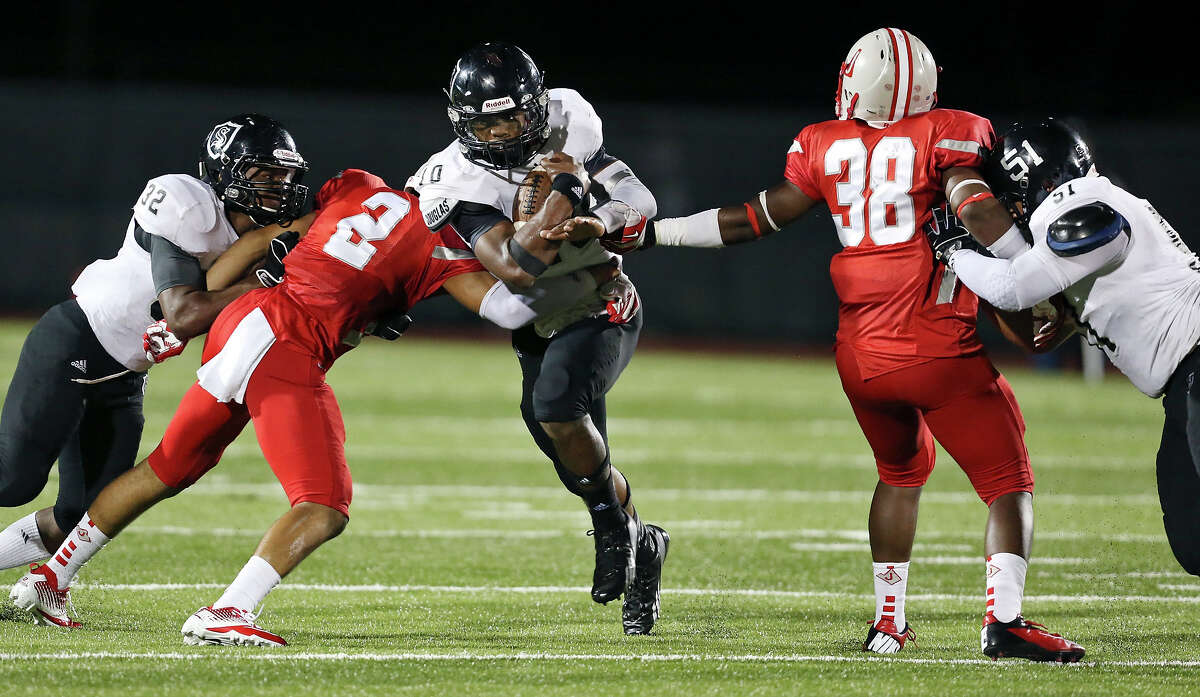 Steele's L.G. Williams (center) looks for room between Judson's Shawn Calvin (center left) and Rashawn Pickens as Steele's Keshawn Brown (left) and J.P. Fernandez block during second half action Friday Sept. 6, 2013 at D.W. Rutledge Stadium. Steele won 51-34.