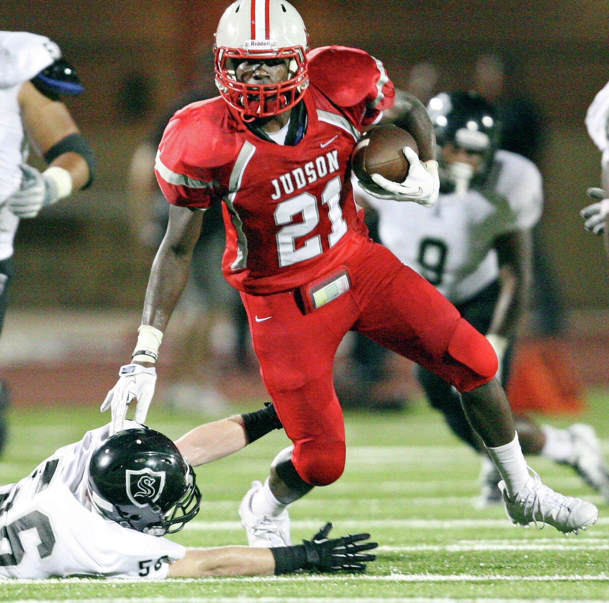 Judson's Cedric Williams looks for room around Steele's Chris Boring during second half action Friday Sept. 6, 2013 at D.W. Rutledge Stadium. Steele won 51-34.