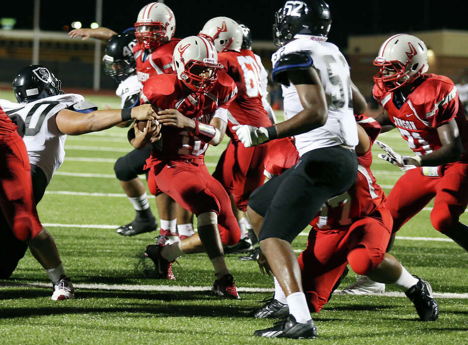 Judson's Rayjohn Austin-Ramsey (center) scores a touchdown around Steele's Mason Martinez during second half action Friday Sept. 6, 2013 at D.W. Rutledge Stadium. Steele won 51-34. Photo: Edward A. Ornelas, San Antonio Express-News / © 2012 San Antonio Express-News