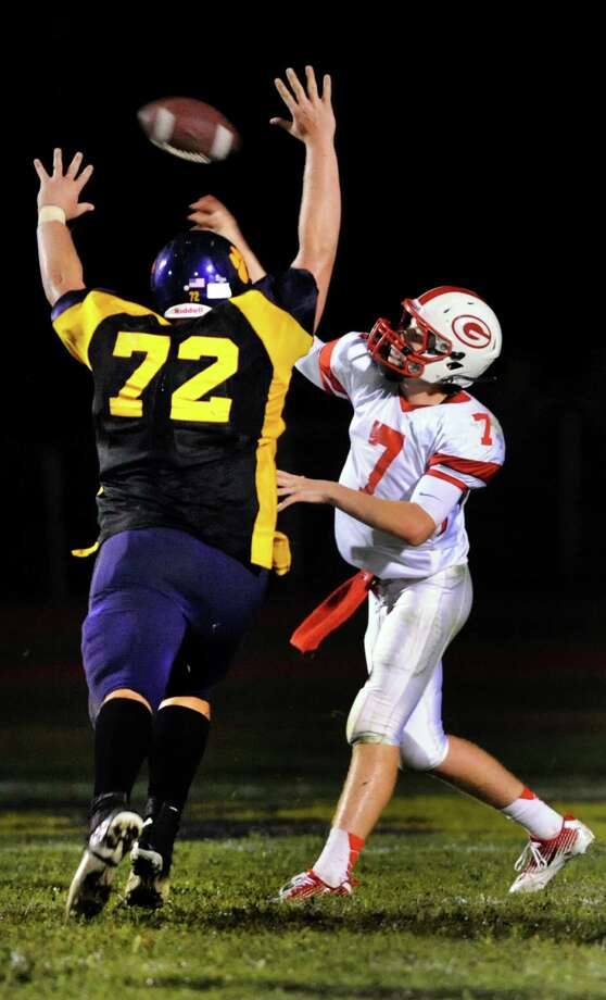 Guilderland's quarterback Frank Gallo, right, throws a pass as Ballston Spa's Chris Stedry defends during their football game on Friday, Sept. 6, 2013, at Ballston Spa High in Ballston Spa, N.Y. (Cindy Schultz / Times Union) Photo: Cindy Schultz / 00023762A