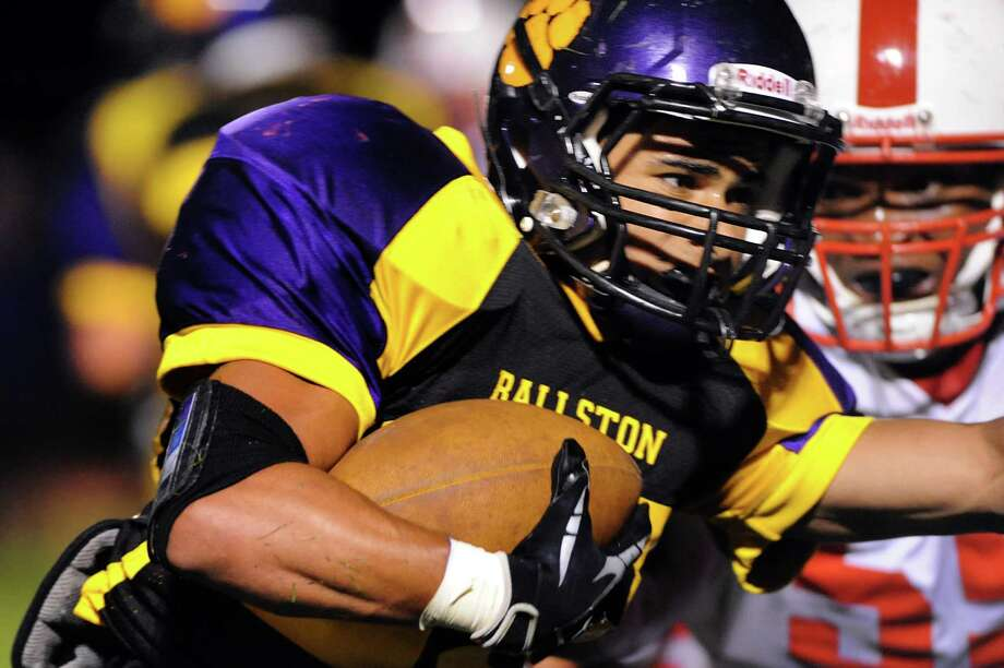 Ballston Spa's Kiernan Mack, left, carries the ball during their football game against Guilderland on Friday, Sept. 6, 2013, at Ballston Spa High in Ballston Spa, N.Y. (Cindy Schultz / Times Union) Photo: Cindy Schultz / 00023762A