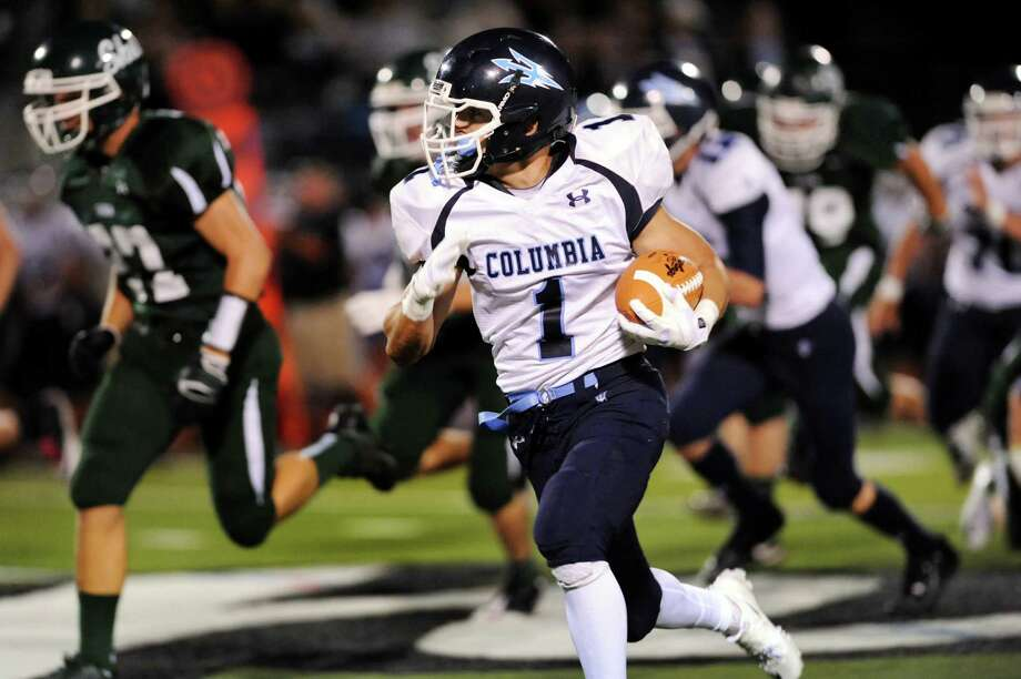 Columbia's Conner Kinzelmann, center, carries the ball during their football game against Shenendehowa on Friday, Sept. 6, 2013, at Shenendehowa High in Clifton Park, N.Y. (Cindy Schultz / Times Union) Photo: Cindy Schultz / 00023759A