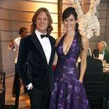 Darren Bechtel and Samantha DuVall pose for a photograph at the 91st San Francisco Season-Opening Opera Gala in San Francisco Calif. on Friday, Sept. 6, 2013. The couple stood out in a bespoke suit and Azadeh gown.