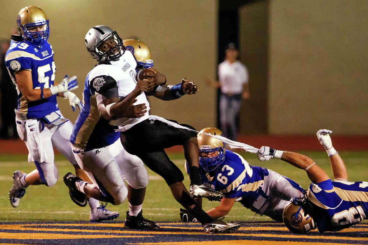 Clark quarterback Trenton Ford is sacked by Alamo Heights' Connor Gates (right) and Micah Dennis (second from left) during the fourth quarter of their game at Orem Stadium on Friday, Sept. 6, 2013. Alamo Heights won the game 47-34. MARVIN PFEIFFER/ mpfeiffer@express-news.net