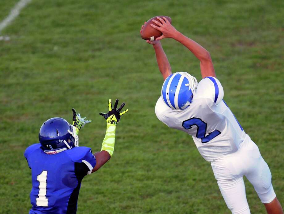 Shaker's Ian Parkinson (1) intercepts a ball intended for La Salle's Matt Woods during their Class AA football game in Troy, N.Y., Friday, Sept. 6, 2013. (Hans Pennink / Special to the Times Union) ORG XMIT: HP101 Photo: Hans Pennink / Hans Pennink