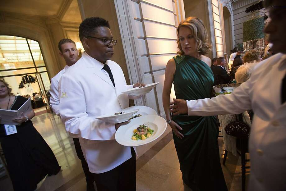 A waiter carries plates of food during dinner service at the 91st Season Opening Night Gala of the San Francisco Opera at War Memorial Opera House in San Francisco, Calif. on Friday, Sept. 6, 2013. Photo: Stephen Lam, Special To The Chronicle